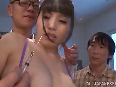 Asian babe with huge tits enjoying a hardcore gangbang