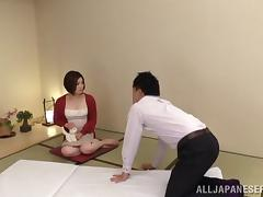 Japanese milf gets fucked after giving a nice handjob
