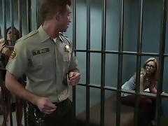 Brunette porn star with a fabulous body enjoying a hardcore threesome in a prison tube porn video
