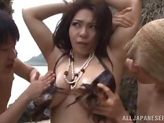 Chubby Japanese girl with big tits enjoying a hardcore gangbang on a beach tube porn video