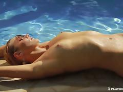 Gorgeous Gia Marie swims then relaxes by the pool nude