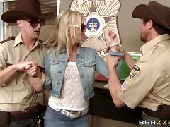 blonde with long hair and glasses drilled by police in uniform