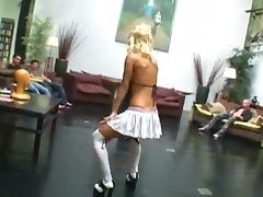 Gorgeous blonde with big fake tits enjoying a hardcore gangbang