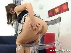 Brunette cutie Carrie shows her pussy and rubs it with a toy