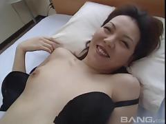 Attractive Asian babes with small tits giving her gentleman superb blowjob