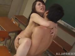 A sexy Japanese teacher fucks her student in her classroom