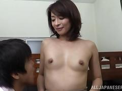 An Asian MILF gets licked then gives her man some head