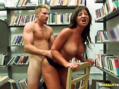 Seductive brunette amateur with big tits and long hair getting banged doggystyle in the library