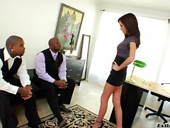 A skinny white girl DP'd by two black guys on her desk in her office