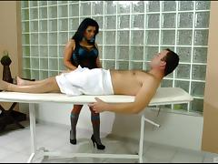 Long haired brunette gets cum on tits after massaging and giving handjob