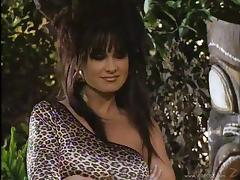 Beautiful cougar with big fake tits enjoying a hardcore missionary style fuck