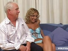 Curly-haired blond milf enjoys jumping on a cock in hardcore clip