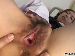 This Asian babe impales her hairy pussy on a nice, hard cock