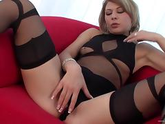 Lingerie-clad blonde with a shaved pussy enjoying a hardcore doggy style fuck
