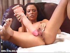 Skinny bitch destroys her crotch with gigantic dildos