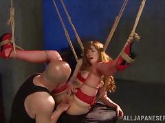 Kinky bondage action with a Japanese girl tied up and punished