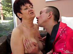 Appreciative mature granny awarding her horny guy with superb blowjob