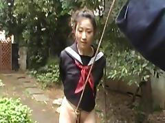 Suspended Japanese woman sucks a cock in the garden