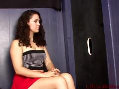 Attractive brunette with natural tits busting balls through gloryhole in femdom sex tube porn video