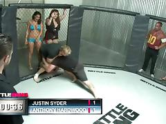A sporty babe gets fucked hard in the middle of a cage fighting cage
