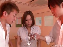Two guys tag team a busty Japanese girl and jizz all over her