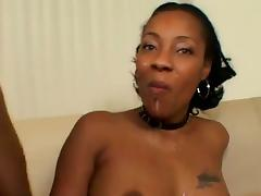Busty ebony slut shows her butt and tits for the cam
