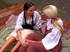 Pigtailed blonde lesbian and her GF get naughty in the yard