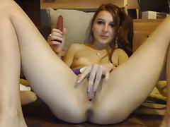 Girl rubs her clit while fucking her pussy with dildo tube porn video