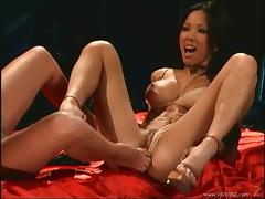 Angelic Asian lesbian with fake tits licking her babes pussy before getting fingered