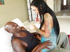 Curvy tattooed cutie in fishnet rides big black cock in interracial