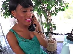 An ebony shamale in fishnets jacks her cock off until she cums