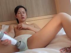 Japanese skank with hairy cunt masturbates